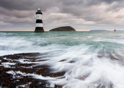 Penmon Point lighthouse on the isle of Anglesey photographed at dawn.