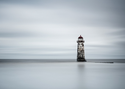 The Point of Ayr Lighthouse, also known as the Talacre Lighthouse shot with a long exposure on the Welsh Coast
