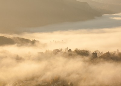 Mist illuminated by the first rays of sunlight above Keswick in the Lake District