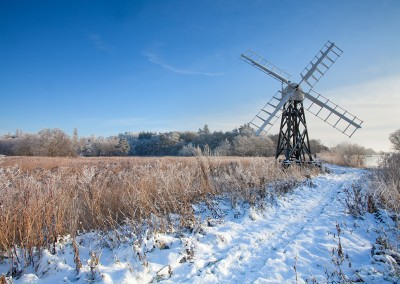 Traditional Skeleton mill of Boardmans on the Norfolk Broads in wintry weather