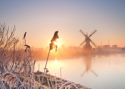 Thurne Drainage Mill at sunrise following an overnight winter hoarfrost on the Norfolk Broads