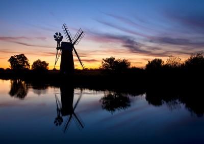Turf Fen Drainage Mill reflecting in the River Ant at sunset on the Norfolk Broads