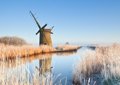 The derelict mill of Brograve on the Norfolk Broads following an overnight winter hoarfrost