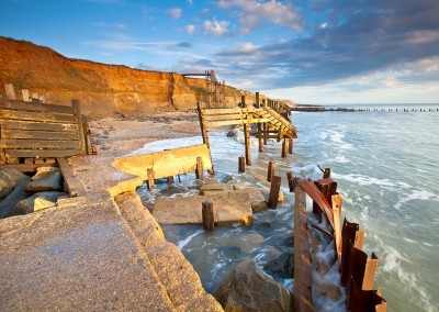 Happisburgh beach and the derelict sea defences captured at first light on the Norfolk Coast