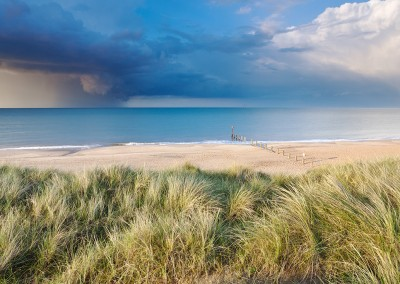 Sand Dunes at Horsey with a dramatic summer storm out at sea