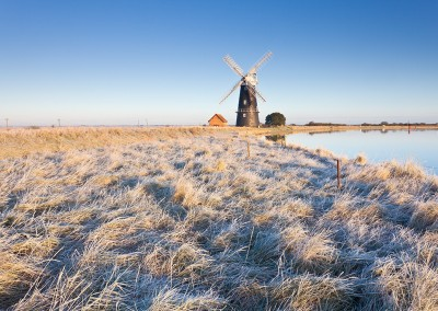 The remote Halvergate Marshes at Berney Arms Mill on the Norfolk Broads. Captured following an overnight hoarfrost.