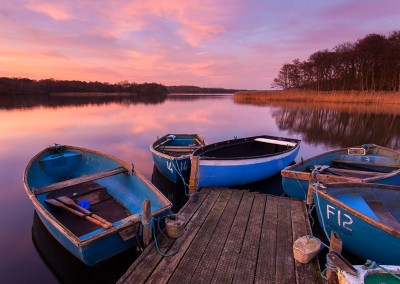 Rowing boats and Jetty at Ormesby Little Broad on the Norfolk Broads