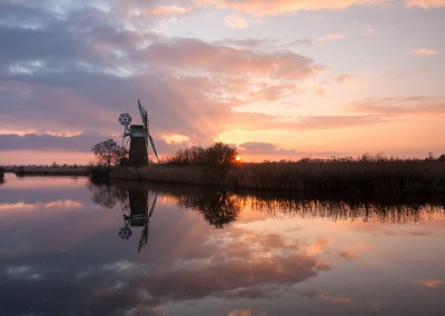 Turf Fen Drainage Mill at sunset on the Norfolk Broads