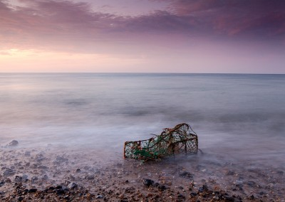A washed up lobster pot on the beach at Cromer Pier on the North Norfolk Coast