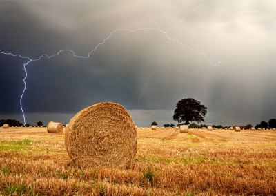 Thunder storm over a Straw Bale field in the Norfolk Countryside