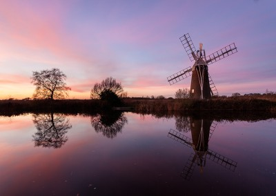 Turf Fen windpump at sunset on the River Ant, Norfolk Broads