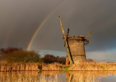 Rainbow over the derelict Brograve drainage mill on the Norfolk Broads