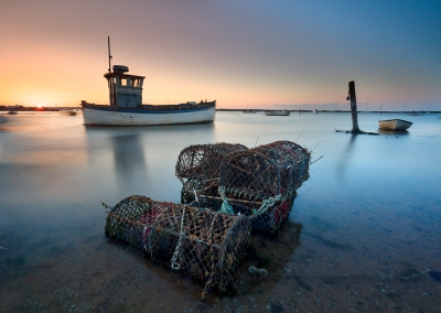 Brancaster Staithe fishing boats at sunset on the North norfolk Coast
