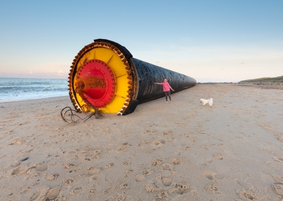 One of many giant pipes washed up onto the Norfolk Coast at Winterton & Horsey. This one was over half a mile long and shows my daughter and dog for scale.