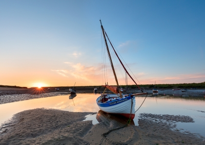 Sailing boat at Burnham Overy Staithe on the North Norfolk Coast