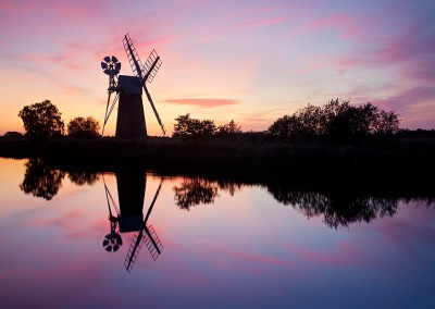 Turf Fen windmill / drainage millat sunset on the River Ant, Norfolk Broads