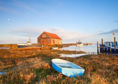Thornham Harbour, Boats & the old coal shed at first light during a high tide on the North Norfolk Coast