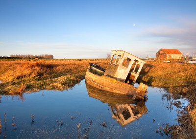 Derelict boat at Thornham Harbour at first light