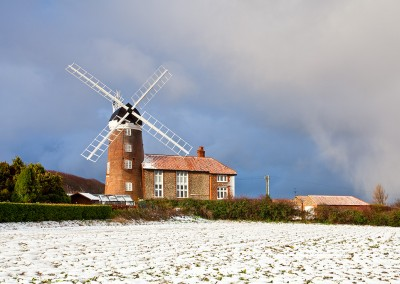 Weybourne windmill following winter snowfall in Norfolk