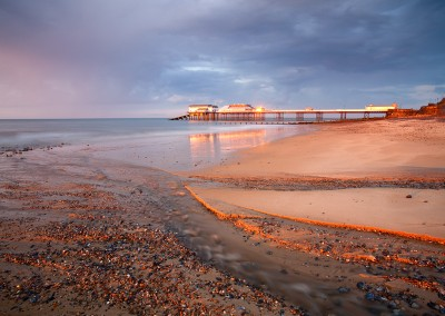 Stomy light over Cromer Pier shortly before sunset on the North Norfolk Coast