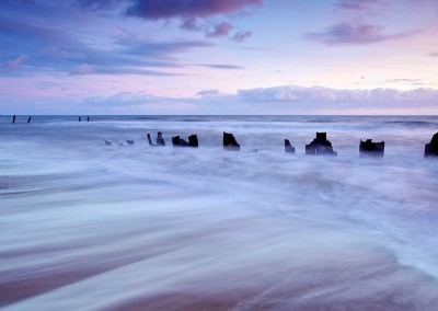 The remains of the now damaged sea defences at Happisburgh on the Norfolk Coast