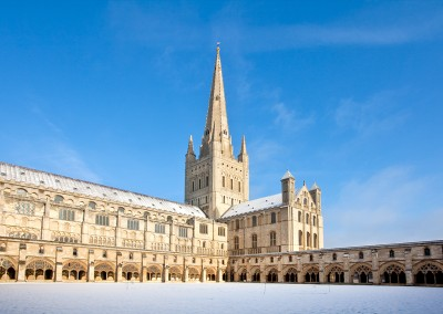 Norwich Cathedral on a bright sunny day following Winter Snowfall