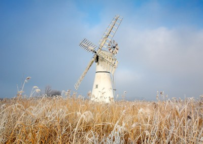Thurne windmill on a frozen day following a winter Hoarfrost on the Norfolk Broads