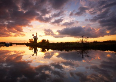 Turf Fen Windmill on the Norfolk Broads reflecting in the River Ant at sunset