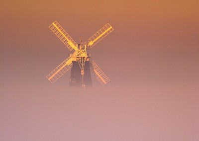 Berney Arms windmill on the Norfolk Broads rising from the Mist on a cold Decembers morning